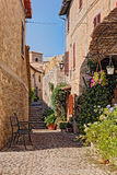 Alley with flowers of a small town in Umbria, Italy Royalty Free Stock Photos