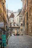 Alley of the historical center of Vienna. WIEN-AUGUST 3: suggestive street in the Old Town of Vienna with local restaurants and people in the background on Stock Photography