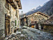 Alley with house of stone in mountain. Traditional stone houses in Italy Alps, Pagliari village Royalty Free Stock Photography