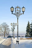 Alley in the Kremlin of Nizhny Novgorod. Lanterns along the snow-covered alley in the city of Nizhny Novgorod Kremlin Stock Photos
