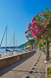 Alley by the lake with yachts, Garda lake, Italy Stock Photos