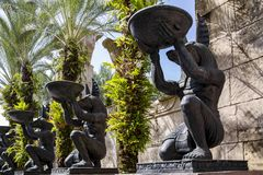Alley with large identical stone statues of the Egyptian God Anubis on a summer sunny day stock photography