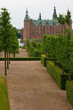 The alley leading to  Frederiksborg castle. The alley leading to Frederiksborg Castle in Hillerod, Denmark Stock Image