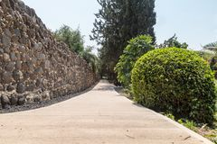 Alley leading to the ruins of a large Byzantine 8th-century Kursi  monastery on the shores of Lake Tiberias. Alley leading to the ruins of a large Byzantine 8th Royalty Free Stock Images