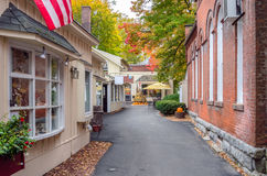 Alley Lined with Traditional Buildings and -Shops in Autumn. Traditional Building and Shops Decorated for Halloween alongside a Narrow Pedestrian Street royalty free stock images