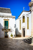 Alley in Locorotondo. With a church on the right side of the image, Puglia, Italy Royalty Free Stock Photo