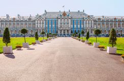 Alley of the Main Courtyard and the western facade of the Great Catherine`s Palace in Tsarskoye Selo Pushkin, Russia. Alley front yard and the Western facade of Stock Photography