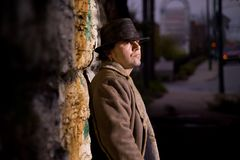 Alley Man. Man with hat in alley waiting royalty free stock image