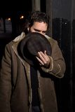 Alley Man. Man with hat covering his face in dark alley Stock Photography