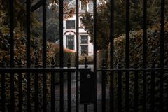 Alley with a mansion behind fence stock photo