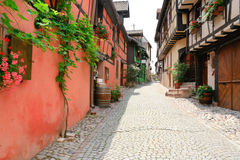 Alley in medieval Riquewihr town, France. Alley in medieval Riquewihr town on wine route Alsace. Riquewihr known for the Riesling and other great wines produced Royalty Free Stock Photo