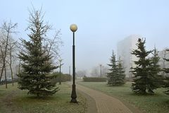 Alley in misty autumn morning during sunrise. First frosts. Moscow Stock Image
