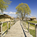 Alley near an old settlement. Old wooden narrow alley near an old lake settlement Royalty Free Stock Images