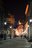 Alley by night. Evening lights illuminating the architecture of an European city alley Royalty Free Stock Images