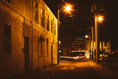 Alley at night, in Hanover, Pennsylvania. Stock Photos