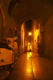 Alley at Night in Monpellier, France. Little alley at night in old centre of Montpellier, France with white scooter stock photo