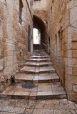 An alley in the old city in Jerusalem. An alley with stairs in the old city in Jerusalem Royalty Free Stock Images