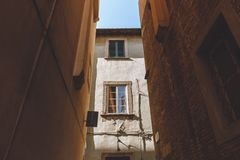 Alley with old historical buildings in Pisa. City, Italy royalty free stock photos
