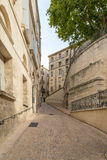 Alley with Old Limestone Houses and Windows, Montpelier, France Royalty Free Stock Photos
