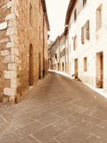 Alley in old Tuscany village . Pienza, Italy Royalty Free Stock Photos