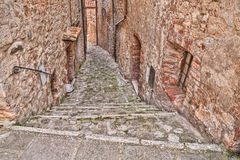 Alley in the old village Castiglione d'Orcia, Siena, Tuscany, It Stock Photo