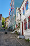 Alley with old wooden houses Stock Photos