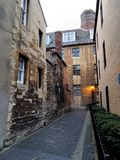 Alley in oxford united kingdom. Back alley in Oxford city centre United Kingdom on a cloudy afternoon. Old historic buildings Stock Images