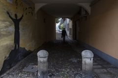 Alley in Padova. Narrow street between the palaces in Padova, Veneto - Italy. Padua a beautiful city. alley with arch. Wall art royalty free stock image