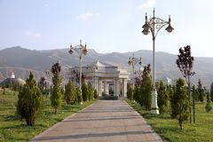 Alley in the park with a lanterns. Ashkhabad. Turkmenistan. Alley in the park with a lanterns. Ashkhabad, Turkmenistan stock photography