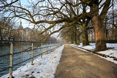 Alley in a park. An alley in winter along the river Eisbach in Munich, Germany Royalty Free Stock Photo