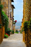 Alley in Pienza, Tuscany. A picturesque alley in Pienza in Italy Stock Photo