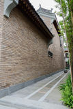 Alley planted with bamboo between Chinese old-fashioned building Royalty Free Stock Photos