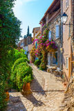 Alley in the Provencal village Grimaud, France royalty free stock photo