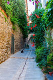 Alley in the Provencal village Grimaud, France royalty free stock photos