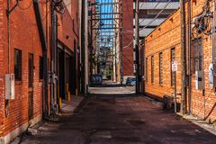 An alley with red brick buildings in Amarillo. Texas Stock Photos