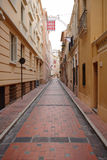 Alley with red cobblestone Stock Photo