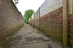 Alley. Sinister alley way behind housing estate, uk Stock Photo