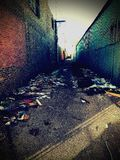 Alley at South side. There is a light at the end of dark alley south side n stock image