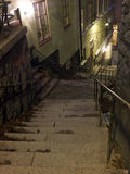 Alley with stairs at night Royalty Free Stock Photo
