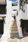 Alley with steps of a fishing village, Menorca, Spain Stock Photos