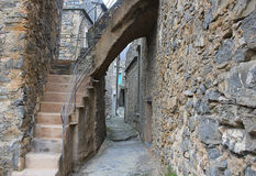 Alley with stone houses. An alley in a village with stone houses Royalty Free Stock Photo