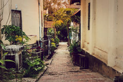 Alley with sunlight. Royalty Free Stock Photo