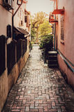 Alley with sunlight. Royalty Free Stock Photography