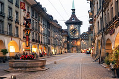 Alley to the clocktower on the old part of Bern. Bern, Switzerland - 17 September 2013: People on the shopping alley with the famous clocktower of Bern on Royalty Free Stock Images