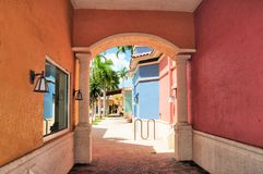 Alley to retail stores in South Florida. Perspective view of very colorful stores in strip center shopping plaza Stock Image