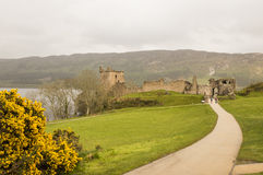 Alley to the Urquhart Castle. With cloudy skies Royalty Free Stock Photo