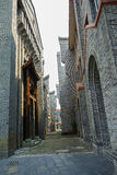 Alley between traditional buildings Royalty Free Stock Image