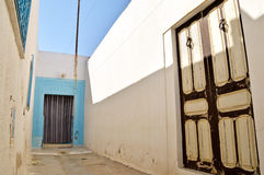 Alley in Tunisia. A narrow alley in Tunisia in a traditional village Royalty Free Stock Images