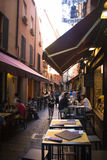Alley with typical restaurants in Bologna, Italy Stock Photos