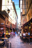 Alley with typical restaurants in Bologna, Italy Stock Image